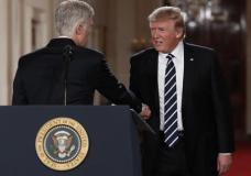 President Donald Trump shakes hands with Judge Neil Gorsuch in East Room of the White House in Washington, Tuesday, Jan. 31, 2017, after announcing Gorsuch as his nominee for the Supreme Court. (AP Photo/Carolyn Kaster)