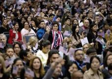 FILE - In this Wednesday, Feb. 15, 2017, file photo, people wave U.S. flags during a naturalization ceremony at the Los Angeles Convention Center, in Los Angeles. Since Trump's immigration enforcement order and travel ban, immigrants have been rushing to prepare applications to become Americans. Advocates in Los Angeles, Maryland and New York catering to diverse immigrant communities from Latin America, Asia and the Middle East all said they've been fielding a rising number of questions about how to become a U.S. citizen. (AP Photo/Jae C. Hong, File)