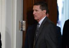 "FILE - In this Feb. 13, 2017 file photo, Mike Flynn arrives for a news conference in the East Room of the White House in Washington. Flynn's attorney says the former national security adviser is in discussions with the House and Senate intelligence committees on receiving immunity from ""unfair prosecution"" in exchange for questioning. Flynn attorney Robert Kelner says no ""reasonable person"" with legal counsel would answer questions without assurances. (AP Photo/Evan Vucci, File)"