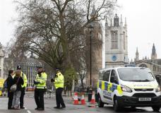 Police direct pedestrians around a cordon in place following Wednesday's terror attack, in London, Thursday March 23, 2017. On Wednesday a knife-wielding man went on a deadly rampage, first driving a car into pedestrians before stabbing a police officer to death and then was fatally shot by police within Parliament's grounds in London. Five people were killed, including the assailant.(AP Photo/Kirsty Wigglesworth)