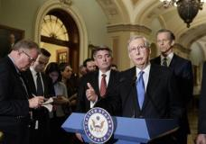 Senate Majority Leader Mitch McConnell, R-Ky., joined by Sen. Cory Gardner, R-Colo., left, and Sen. John Thune, R-S.D., speak on Capitol Hill before President Donald Trump's speech to the nation, in Washington, Tuesday, Feb. 28, 2017. (AP Photo/J. Scott Applewhite)