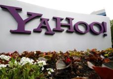 In this April 18, 2011 file photo, the Yahoo logo is seen outside of the offices in Santa Clara, Calif. A law enforcement official says the Justice Department is preparing to announce charges against four defendants, including two officers of Russian security services, in a mega data breach at Yahoo. (AP Photo/Paul Sakuma, File)