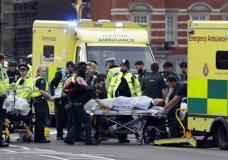 "Emergency services transport an injured person to an ambulance, close to the Houses of Parliament in London, Wednesday, March 22, 2017. London police say they are treating a gun and knife incident at Britain's Parliament ""as a terrorist incident until we know otherwise."" The Metropolitan Police says in a statement that the incident is ongoing. Officials say a man with a knife attacked a police officer at Parliament and was shot by officers. Nearby, witnesses say a vehicle struck several people on the Westminster Bridge. (AP Photo/Matt Dunham)"