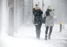 Two women struggle to walk in the blowing snow during a winter storm Tuesday, March 14, 2017, in Boston. (AP Photo/Michael Dwyer)