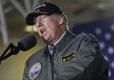 President Donald Trump speaks while aboard the nuclear aircraft carrier Gerald R. Ford, Thursday, March 2, 2017, at Newport News Shipbuilding in Newport, Va. Trump traveled to Virginia to meet with sailors and shipbuilders on aircraft carrier which is scheduled to be commissioned this year after cost overruns and delays. (AP Photo/Pablo Martinez Monsivais)
