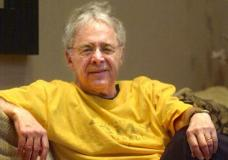 """FILE - In this Dec. 20, 2002 file photo, Chuck Barris, the man behind TV's """"The Dating Game,"""" poses in the lobby of his apartment in New York. Game show impresario Barris has died at 87. Barris, the madcap producer of """"The Gong Show"""" and """"The Dating Game,"""" died of natural causes Tuesday afternoon, March 21, 2017, at his home in Palisades, New York. (AP Photo/Bebeto Matthews, File)"""