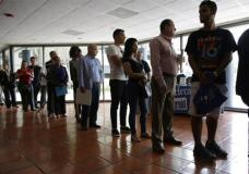 FILE - In this Tuesday, July 19, 2016, file photo, people stand in line to register for a job fair, in Miami Lakes, Fla. On Thursday, April 20, 2017, the Labor Department reported that more people sought U.S. unemployment benefits the week before, yet total applications remained at a historically low level that suggests workers are enjoying solid job security. (AP Photo/Lynne Sladky, File)