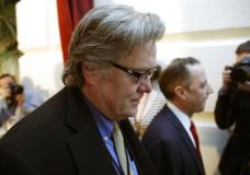 FILE - In this March 23, 2017 file photo, White House chief strategist Steve Bannon, left, walks on Capitol Hill in Washington. President Donald Trump removed Bannon from the National Security Council, reversing an earlier controversial decision to give Bannon access to the high-level meetings. (AP Photo/Alex Brandon, File)