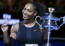 FILE - In this Jan. 28, 2017, file photo, Serena Williams holds up a finger and her trophy after defeating her sister, Venus, in the women's singles final at the Australian Open tennis championships in Melbourne, Australia. Serena Williams is briefly back at No. 1 in the WTA rankings, despite not having played a match since January, and with plans to take the rest of 2017 off because she is expecting a baby. Thanks to a calendar quirk, Williams moved up one spot from No. 2, swapping places with Angelique Kerber. (AP Photo/Aaron Favila, File)