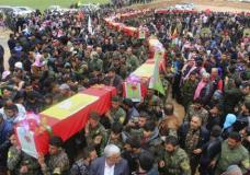This photo provided by Hawar News Agency, a Kurdish-run news agency, which has been authenticated based on its contents and other AP reporting, shows fighters from the predominantly-Kurdish Syrian Democratic Forces carrying the coffins of their comrades, who were killed Tuesday by a misdirected airstrike by the U.S.-led coalition, during their funeral procession, in Tal al-Abyad, northeast Syria, Thursday, April 13, 2017. U.S. Central Command said coalition aircraft were given the wrong coordinates by their partner forces, the Syrian Democratic Forces, for a strike intended to target Islamic State militants south of their Tabqa stronghold. (Hawar News Agency via AP)