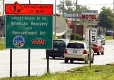 "FILE - In this June 18, 2009, file photo a road sign reading ""Putting America to Work"" and ""Project Funded by the American Recovery and Reinvestment Act"" is seen along Route 120 in Waukegan, Ill. President Donald Trump disparaged his predecessor's economic stimulus spending Tuesday as a windfall for social programs and said he's unaware of anything built from the money steered to infrastructure. (AP Photo/Jim Prisching, File)"