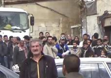 This frame grab from video provided by the government-controlled Syrian Central Military Media, shows Syrian citizens gather to in buses as they leave from Madaya an opposition-held town near Damascus, Syria, Friday, April 14, 2017. The Syrian government and rebels began a coordinated population transfer Friday of about 10,000 people from four towns besieged for years amid the country's bloody, six-year civil war. (Syrian Central Military Media, via AP)