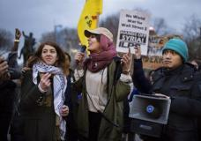 """Protesters shout slogans during a rally against the U.S. missile strikes in Syria, Friday, April 7, 2017, in New York. Hundreds of demonstrators took to New York City streets chanting """"Hands off Syria!"""" and """"Money for jobs and education, not for war and occupation!"""" The U.S. fired a barrage of cruise missiles into Syria on Thursday night in retaliation for a chemical weapons attack against civilians earlier in the week. (AP Photo/Andres Kudacki)"""
