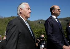 U.S. Secretary of State Rex Tillerson (L) and Italy's Foreign Minister Angelino Alfano arrive to attend a ceremony at the Sant'Anna di Stazzema memorial, dedicated to the victims of the massacre committed in the village of Sant'Anna di Stazzema by Nazis in 1944 during World War II, Italy April 10, 2017. REUTERS/Max Rossi