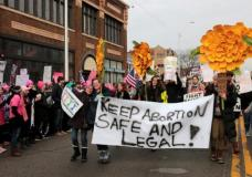 Supporters of Planned Parenthood rally outside a Planned Parenthood clinic in Detroit, Michigan, U.S. February 11, 2017.  REUTERS/Rebecca Cook