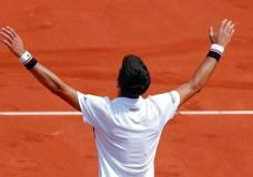Serbia's Novak Djokovic celebrateS his three set win, 6-3, 6-4, 6-2, over Spain's Marcel Granollers in the first round match of the French Open tennis tournament at the Roland Garros stadium, in Paris, France. Monday, May 29, 2017. (AP Photo/Christophe Ena)