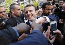 French independent centrist presidential candidate Emmanuel Macron shakes hands to supporters as he campaigns in Rodez, southern France, Friday, May 5, 2017. The 39-year-old independent candidate faces far-right National Front leader Marine Le Pen in Sunday's presidential runoff. (AP Photo/Christophe Ena)
