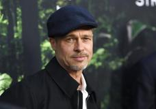 """FILE - In this April 5, 2017, file photo, Brad Pitt arrives at the Los Angeles premiere of """"The Lost City of Z"""" at the ArcLight Hollywood. Pitt told GQ Style magazine for an interview published online May 3, 2017, that he quit drinking since Angelina Jolie filed for divorce in Sept. 2016. (Photo by Chris Pizzello/Invision/AP, File)"""