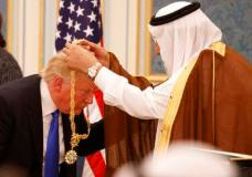 Saudi King Salman presents President Donald Trump with The Collar of Abdulaziz Al Saud Medal at the Royal Court Palace, Saturday, May 20, 2017, in Riyadh. (AP Photo/Evan Vucci)