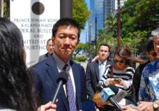 FILE--In this March 29, 2017, file photo, Hawaii Attorney General Douglas Chin speaks outside federal court in Honolulu, Hawaii. Three federal appellate court judges in Seattle on Monday, May 15, will hear the appeal of Hawaii's challenge to President Trump's travel ban targeting six predominantly Muslim countries. (AP Photo/Caleb Jones, File)