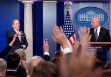 """White House press secretary Sean Spicer, left, calls on a reporter as National Security Adviser H.R. McMaster listens at right during a briefing at the White House in Washington, Tuesday, May 16, 2017. President Donald Trump claimed the authority to share """"facts pertaining to terrorism"""" and airline safety with Russia, saying in a pair of tweets he has """"an absolute right"""" as president to do so. (AP Photo/Susan Walsh)"""
