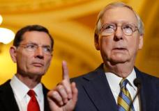 Senate Majority Leader Mitch McConnell of Ky., right, accompanied by Sen. John Barrasso, R-Wyo., meets with reporters on Capitol Hill in Washington, Tuesday, May 23, 2017, following after a Republican policy luncheon.  (AP Photo/Jacquelyn Martin)