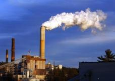 """FILE - In this Jan. 20, 2015 file photo, a plume of steam billows from the coal-fired Merrimack Station in Bow, N.H. President Donald Trump said the United States """"will continue to be the cleanest and most environmentally friendly country on Earth"""" as he announced pulling out of an international accord designed to curb climate change.  But facts muddy that claim. Data show the U.S. is among the dirtiest countries when it comes to heat-trapping carbon pollution. One nation that has cleaner air in nearly every way is Sweden.  (AP Photo/Jim Cole, File)"""