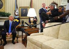 President Donald Trump answers a question from the media, during a meeting with Romanian President Klaus Werner Iohannis, not shown, in the Oval Office at the White House, Friday, June 9, 2017, in Washington. (AP Photo/Andrew Harnik)