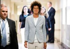 Andrea Constand walks to the courtroom during Bill Cosby's sexual assault trial at the Montgomery County Courthouse in Norristown, Pa., Tuesday, June 6, 2017. Cosby is charged with sexually assaulting Constand at his suburban Philadelphia estate in 2004. (AP Photo/Matt Rourke, Pool)