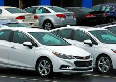 In this Thursday, Jan. 12, 2017, photo, Chevrolet cars are on sale at a dealership lot in Pittsburgh. On Thursday, June 1, 2017, the major automakers report sales for the month of May. (AP Photo/Gene J. Puskar)