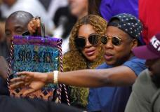"FILE - In this April 30, 2017, file photo, Beyonce and Jay Z watch during the first half in Game 7 of an NBA basketball first-round playoff series between the Los Angeles Clippers and the Utah Jazz in Los Angeles. Jay Z opened up about his relationship with Beyonce on his new album, ""4:44,"" which was released June 30, 2017. (AP Photo/Mark J. Terrill, File)"