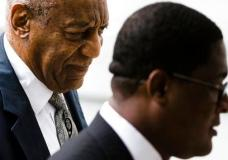 Bill Cosby, left, accompanied by Andrew Wyatt arrives for his sexual assault trial at the Montgomery County Courthouse in Norristown, Pa., Saturday, June 17, 2017. (AP Photo/Matt Rourke)