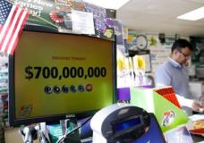 A Powerball lottery sign displays the lottery prizes at a convenience store Wednesday, Aug. 23, 2017, in Northbrook, Ill. Lottery officials said the grand prize for Wednesday night's drawing has reached $700 million, the second -largest on record for any U.S. lottery game. (AP Photo/Nam Y. Huh)