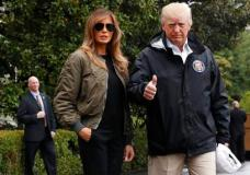 President Donald Trump, accompanied by first lady Melania Trump, gives a thumbs-up as they walk to Marine One on the South Lawn of the White House in Washington, Tuesday, Aug. 29, 2017, for a short trip to Andrews Air Force Base, Md., then onto Texas to survey the response to Hurricane Harvey. The hurricane is the first major disaster of Trump's presidency.  (AP Photo/Jacquelyn Martin)