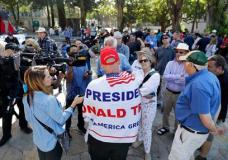 """Donald Trump supporter Arthur Schaper, center, argues opposing views during a free speech rally Sunday, Aug. 27, 2017, in Berkeley, Calif. Protesters gathered for a """"Rally Against Hate"""" in response to a planned right-wing protest that raised concerns of clashes and prompted a large police presence. (AP Photo/Marcio Jose Sanchez)"""