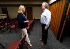 """In this Wednesday, Aug. 2, 2017 photo, U.S. Rep. David Young, R-Iowa, speaks with Glenwood Area Chamber of Commerce Executive Director Linda Washburn, left, during a stop at the Glenwood City Hall,  in Glenwood, Iowa. Conservatives in Young's district are angry with the GOP's failure to repeal and replace Obamacare. Independents don't like the partisan approach. And now Democrats are making an issue of Young's vote for a health care bill that President Donald Trump called """"mean."""" (AP Photo/Charlie Neibergall)"""