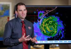 Michael Brennan, branch chief at the National Hurricane Center, gives an update on Hurricane Harvey as it moves toward the Texas coast, Friday, Aug. 25, 2017, in Miami.  The National Hurricane Center warns that conditions are deteriorating as Hurricane Harvey strengthens and slowly moves toward the Texas coast.  (AP Photo/Lynne Sladky)