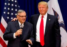 """FILE - In this Jan. 26, 2016 file photo, then-Republican presidential candidate Donald Trump is joined by Joe Arpaio, the sheriff of metro Phoenix, at a campaign event in Marshalltown, Iowa. President Donald Trump has pardoned former sheriff Joe Arpaio following his conviction for intentionally disobeying a judge's order in an immigration case. The White House announced the move Friday night, Aug. 25, 2017, saying the 85-year-old ex-sheriff of Arizona's Maricopa County was a """"worthy candidate"""" for a presidential pardon. (AP Photo/Mary Altaffer, File)"""