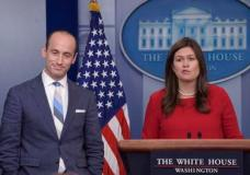 White House press secretary Sarah Huckabee Sanders, right, introduces White House senior policy adviser Stephen Miller to speak during the daily briefing at the White House in Washington, Wednesday, Aug. 2, 2017. (AP Photo/Susan Walsh)