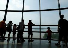 Visitors watch the North side from the unification observatory in Paju, South Korea, Sunday, Aug. 6, 2017. The U.N. Security Council unanimously approved tough new sanctions Saturday to punish North Korea for its escalating nuclear and missile programs including a ban on coal and other exports worth over $1 billion - a huge bite in its total exports, valued at $3 billion last year.(AP Photo/Lee Jin-man)