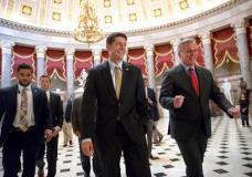Speaker of the House Paul Ryan, R-Wis., center, and Majority Leader Kevin McCarthy, R-Calif., right, walk to the chamber where the House voted overwhelmingly to send a $15.3 billion disaster aid package to President Donald Trump, overcoming conservative objections to linking the emergency legislation to a temporary increase in America's borrowing authority. (AP Photo/J. Scott Applewhite)