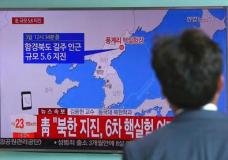 """A man watches a TV news report about a possible nuclear test conducted by North Korea at the Seoul Railway station in Seoul, South Korea, Sunday, Sept. 3, 2017. South Korean officials say they have detected an artificial 5.6 magnitude quake in North Korea and are analyzing whether Pyongyang has conducted its sixth nuclear test. The signs read """" The presidential Blue House analyzing whether North Korea has conducted its sixth nuclear test"""". (AP Photo/Ahn Young-joon)"""