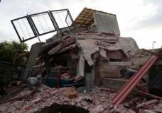 A building demolished by a 7.1 earthquake sits in pile of rubble, in Jojutla, Morelos state, Mexico, Wednesday, Sept. 20, 2017. Police, firefighters and ordinary Mexicans are digging frantically through the rubble of collapsed schools, homes and apartment buildings, looking for survivors of Mexico's deadliest earthquake in decades as the number of confirmed fatalities climbed to 248. (AP Photo/Eduardo Verdugo)