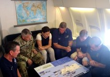 Acting Homeland Secretary Elaine Duke, center, is briefed on the Hurricane Maria response during a flight to Puerto Rico on Friday, Sept. 29, 2017. President Donald Trump on Thursday cleared the way for more supplies to head to Puerto Rico by waiving restrictions on foreign ships delivering cargo to the island. (AP Photo/Luis Alonso Lugo)