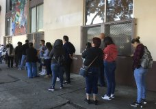 This Sept. 28, 2017 photo shows people waiting in line at CHIRLA (Coalition for Humane Immigrant Rights Los Angeles) for help with immigration paperwork, including renewing work permits for expiring Obama-era program for immigrants brought to the country as children. After Oct. 5, 2017, no one else can renew under the program that has let nearly 800,000 immigrants brought to the United States as children work in the country even though they lack legal papers. (AP Photo/Amy Taxin)