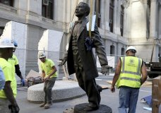 In this Saturday, Sept. 23, 2017, photo, workers install the statue of Octavius Valentine Catto at City Hall in Philadelphia. A century before the fight to end Jim Crow segregation laws, Catto was leading a civil rights movement in Philadelphia. On Tuesday, Sept. 26, the city will laud Catto's legacy with a statue in the shadow of City Hall, the first such named tribute for an African-American in a public space in Philadelphia. (David Maialetti /The Philadelphia Inquirer via AP)