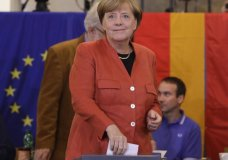 German Chancellor Angela Merkel arrives for a statement on the parliament election at the headquarters of the Christian Democratic Union CDU in Berlin, Germany, Sunday, Sept. 24, 2017. (Joerg Carstensen/dpa via AP)