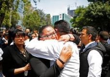 A woman is comforted after an earthquake in Mexico City Tuesday Sept. 19, 2017. A powerful earthquake jolted central Mexico on Tuesday, causing buildings to sway sickeningly in the capital on the anniversary of a 1985 quake that did major damage.(AP Photo/Rebecca Blackwell)