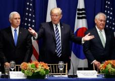 President Donald Trump gestures for people to take their seat at a luncheon with South Korean President Moon Jae-in and Japanese Prime Minister Shinzo Abe at the Palace Hotel during the United Nations General Assembly, Thursday, Sept. 21, 2017, in New York. From left, Vice President Mike Pence, Trump, and Secretary of State Rex Tillerson. (AP Photo/Evan Vucci) The Associated Press