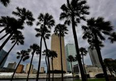 Storm clouds associated with the outer bands of Hurricane Irma shroud the downtown skyline Saturday, Sept. 9, 2017, in Tampa, Fla. Several parts of the Tampa Bay area are under a mandatory evacuation order for the approaching storm. (AP Photo/Chris O'Meara)